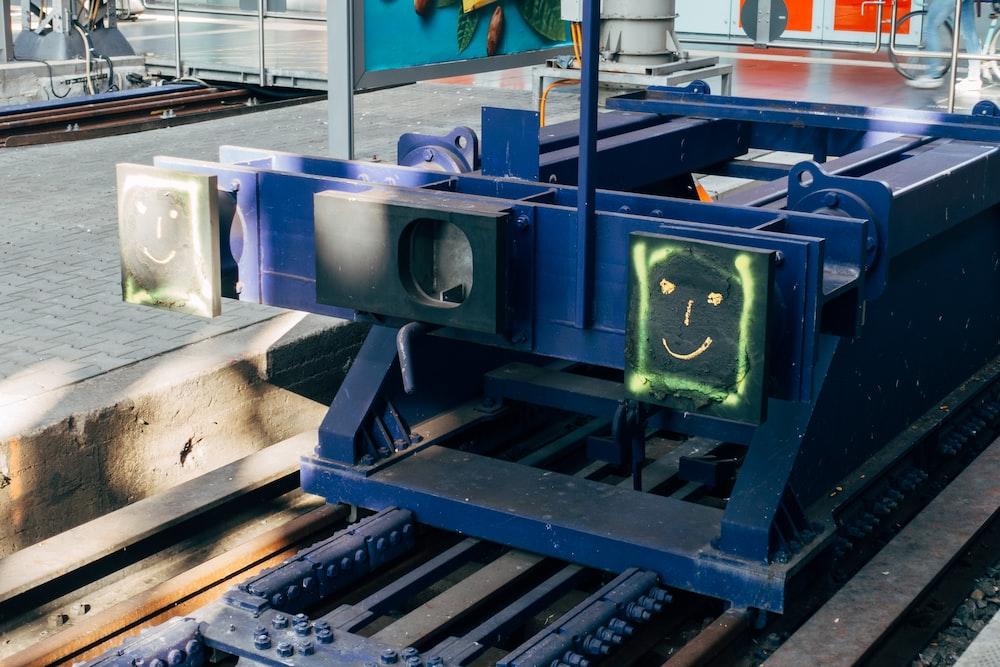 blue and black metal machine