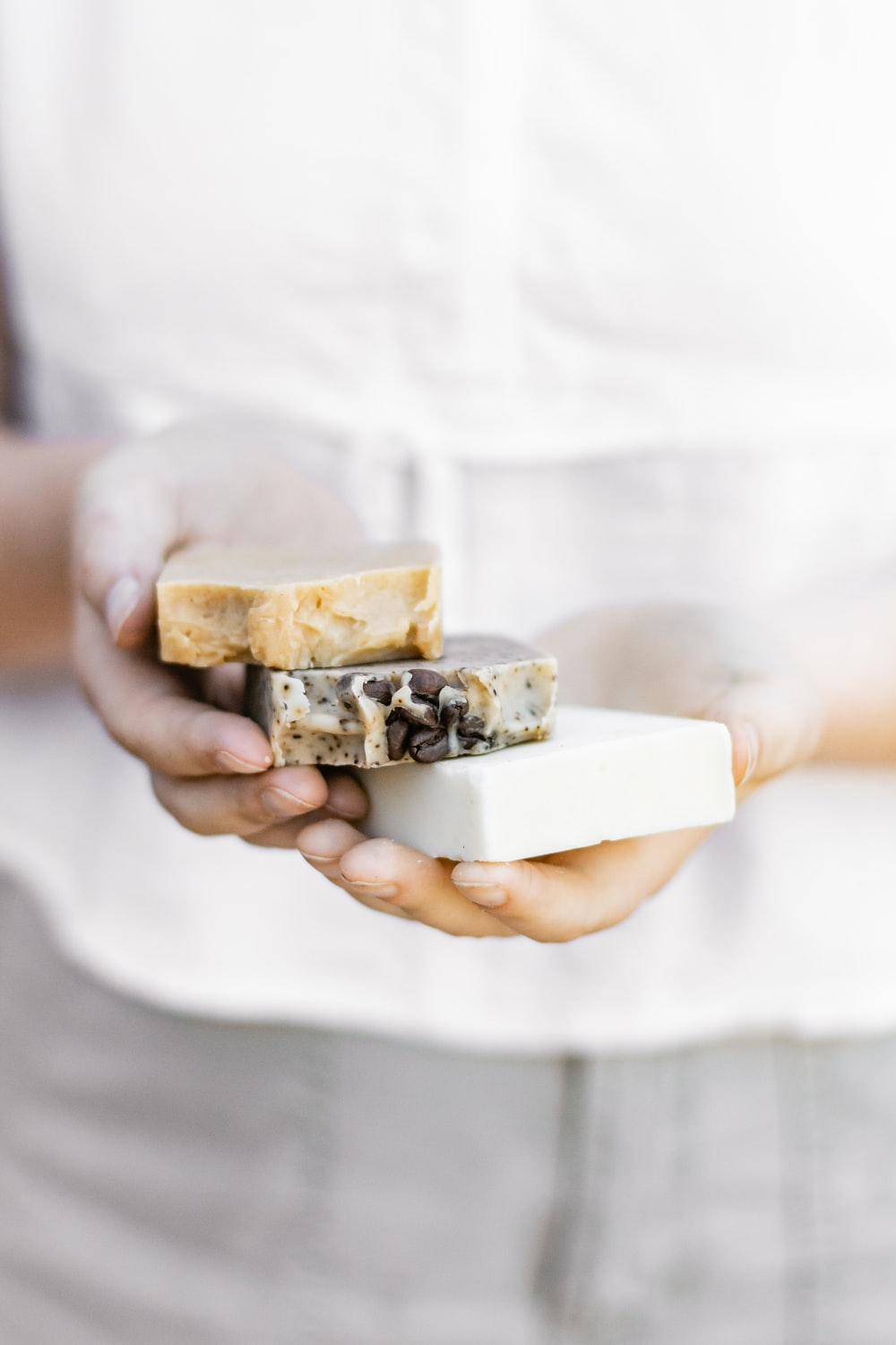 person holding brown and white chocolate bar