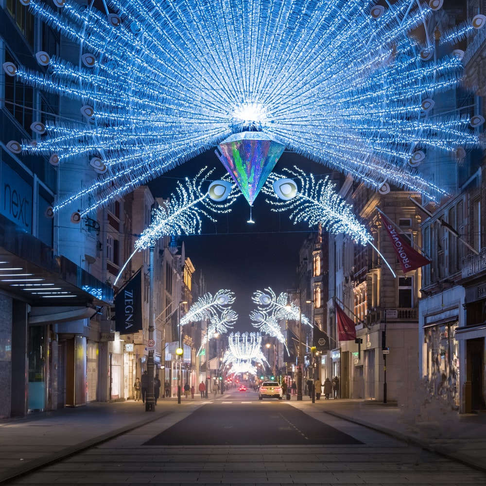 blue and white string lights on street