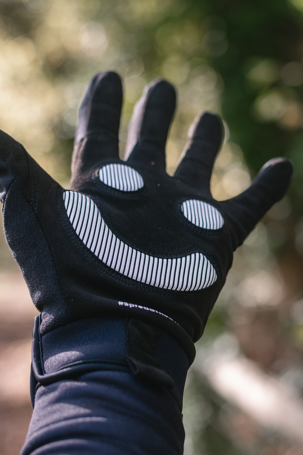person wearing black and white nike gloves