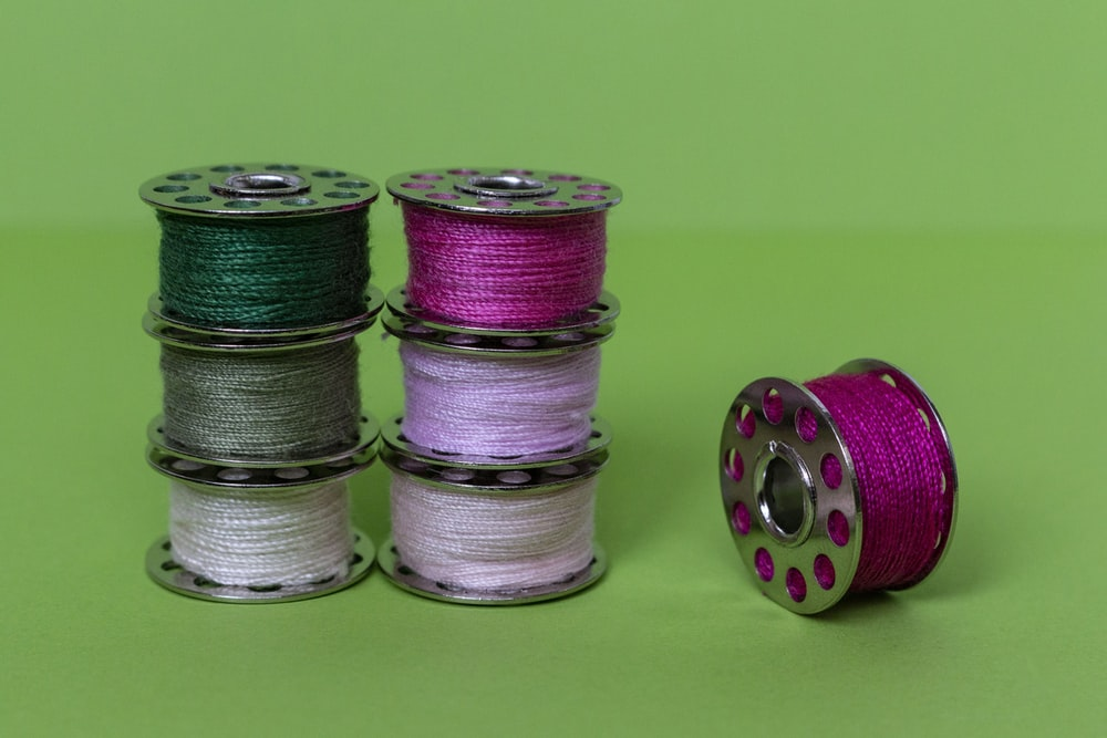 purple green and silver round coins