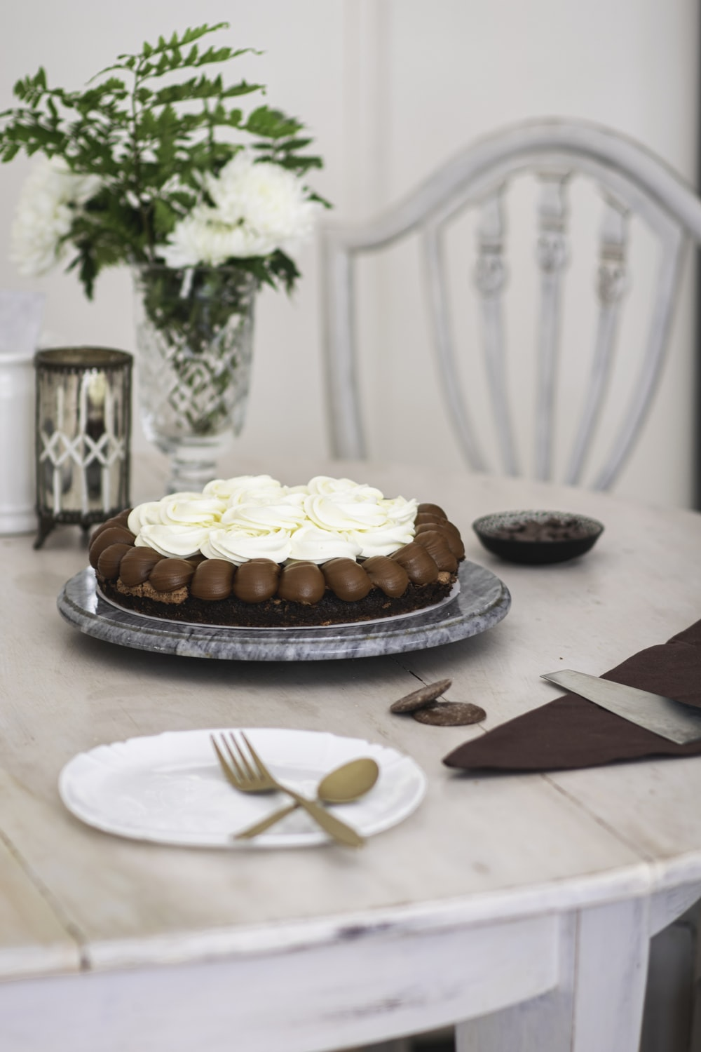 brown and white cake on white ceramic plate