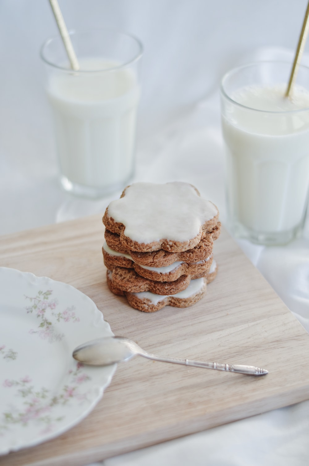 cookies on white ceramic plate beside stainless steel fork