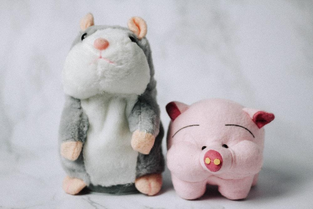 white and gray animal plush toy