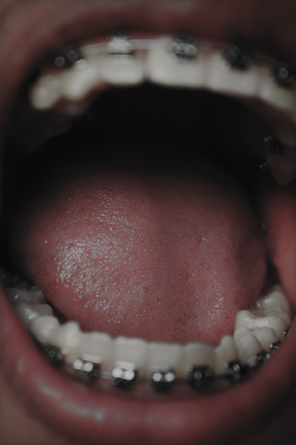 persons mouth open in close up photography