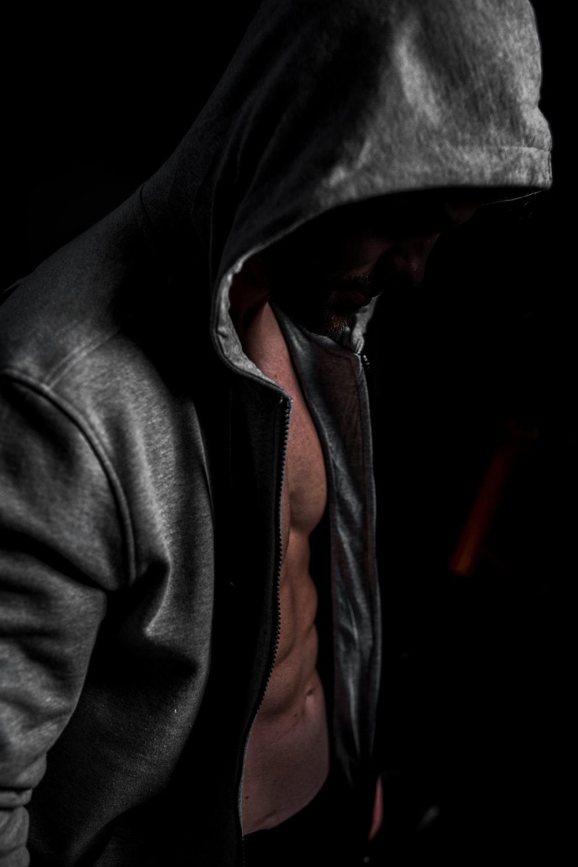 man in black and orange zip up hoodie