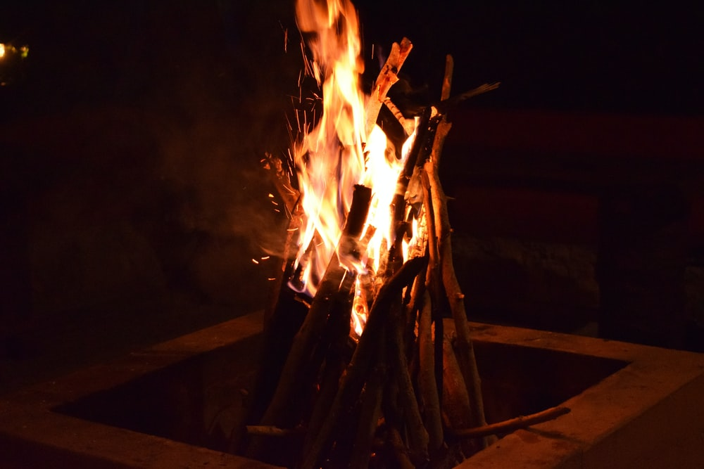 fire on brown wooden stick