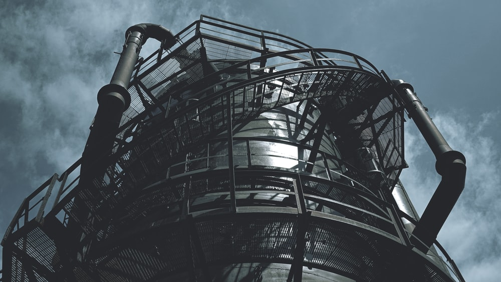 black metal spiral staircase under blue sky during daytime
