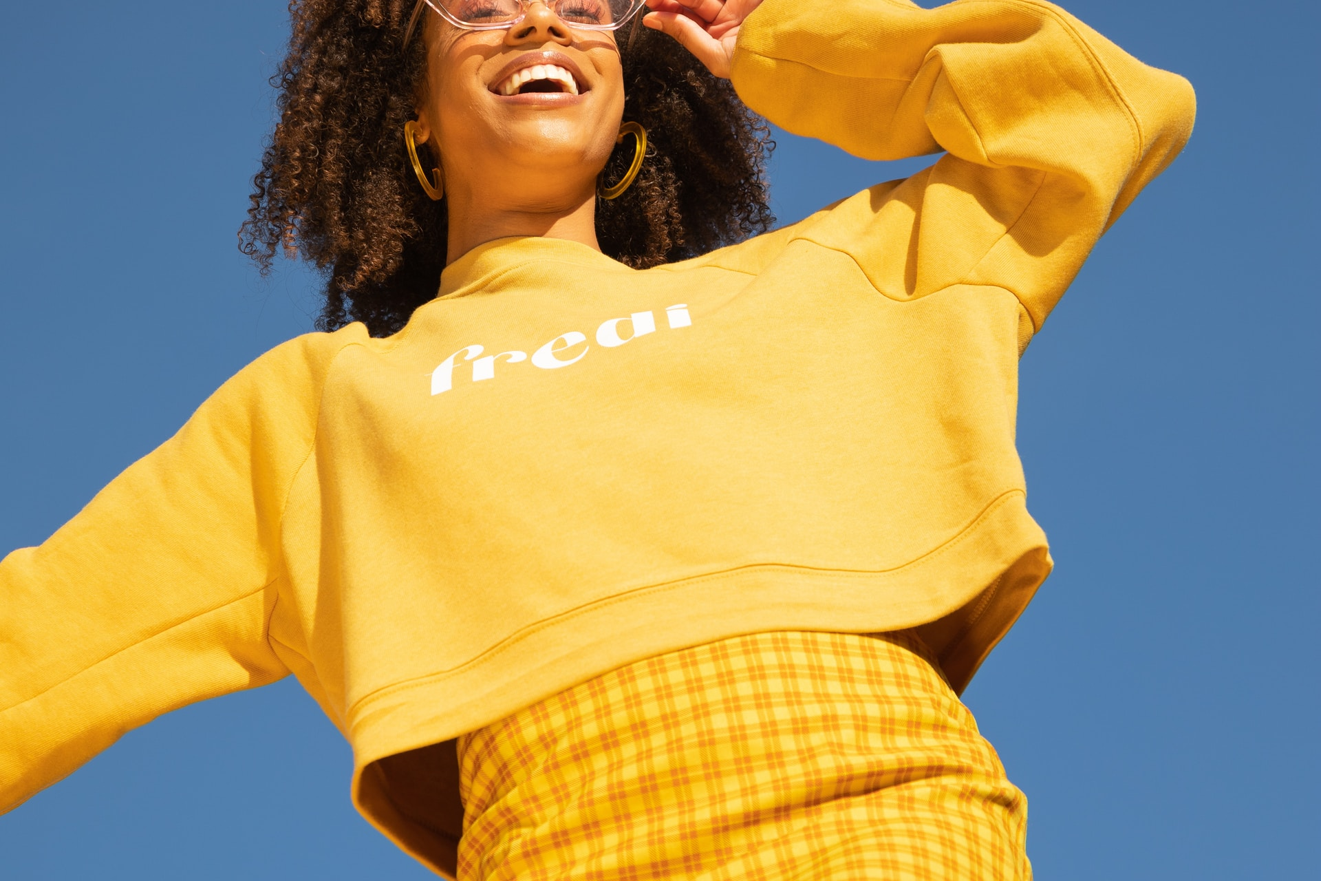 woman in yellow long sleeve shirt
