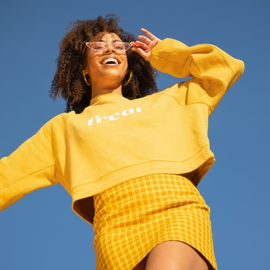 woman in yellow long sleeve shirt
