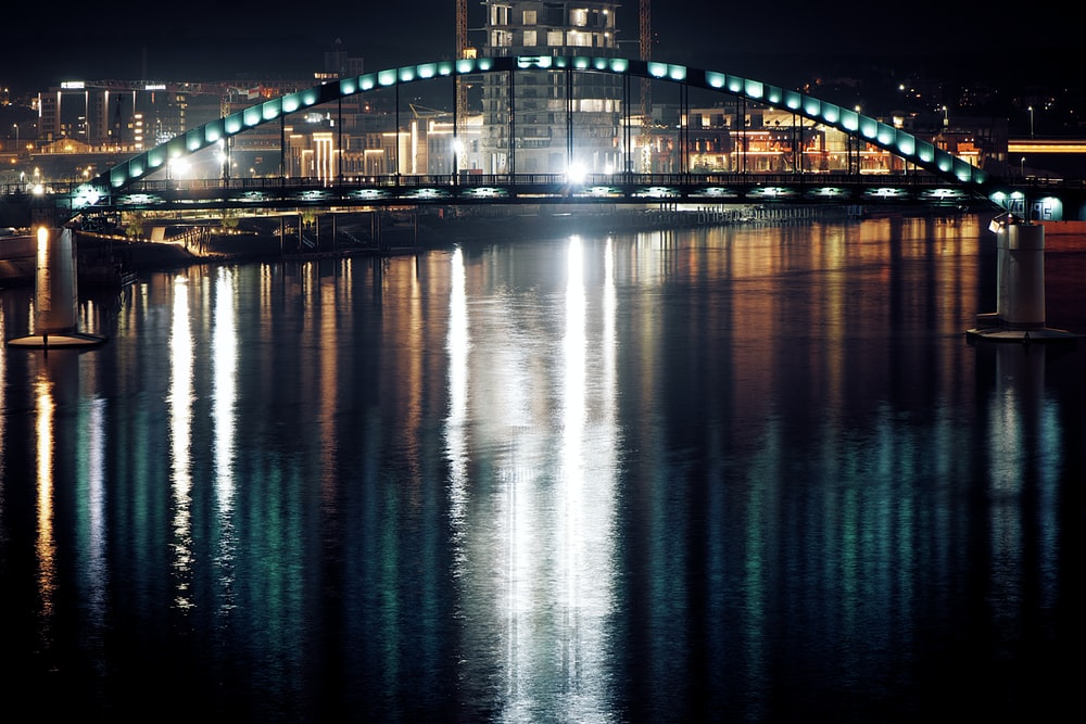 bridge with lights during night time