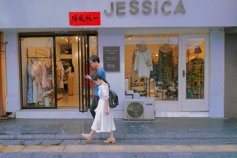 man in white dress shirt and woman in white dress walking on sidewalk during daytime