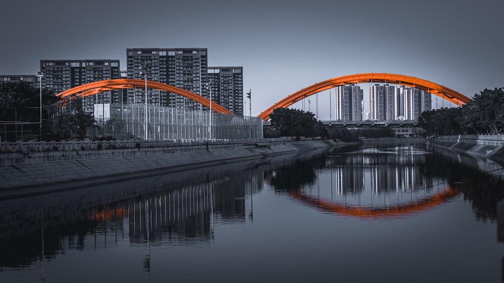 orange and white bridge over river