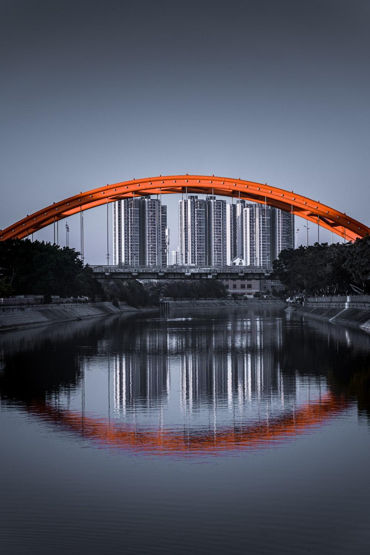 brown arch bridge over river