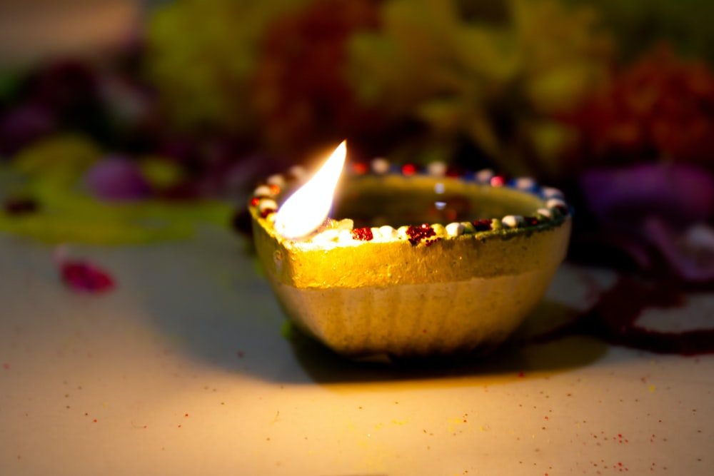 yellow and white lighted candle