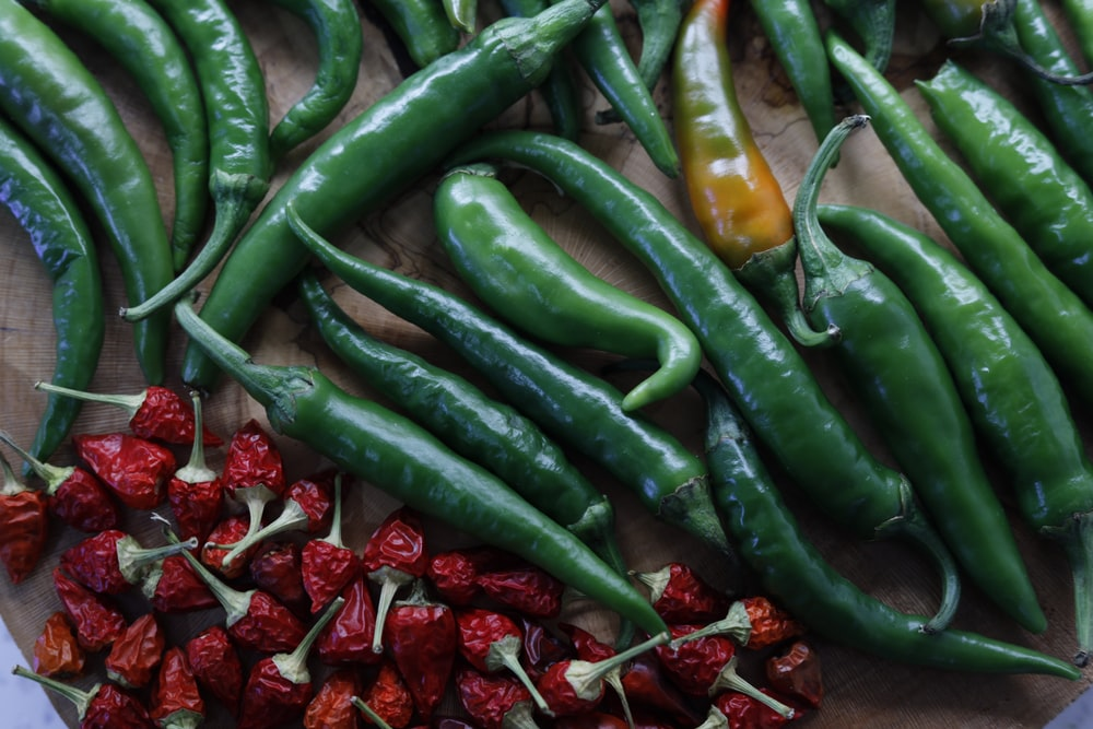 green chili peppers and red strawberries