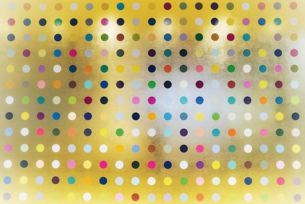 yellow pink and white polka dot illustration
