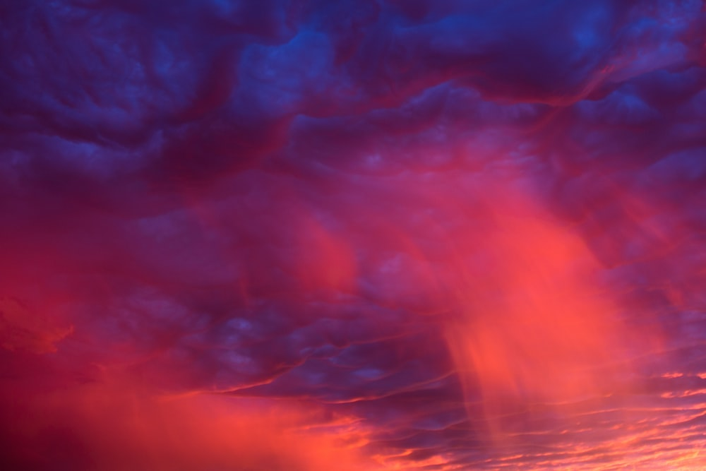 red and blue clouds during night time