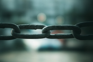 close up photo of gray metal chain