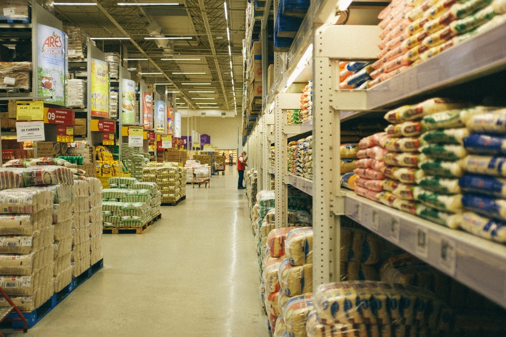 white metal shelf with food packs