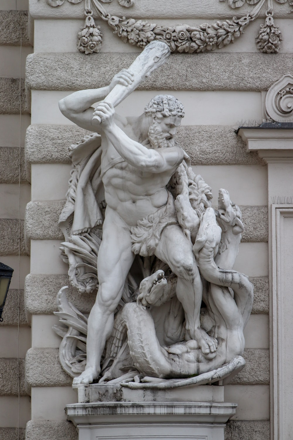 statue of man holding book