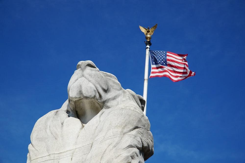 us a flag on gray concrete statue