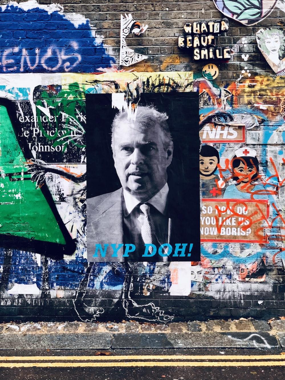 mans face graffiti on wall