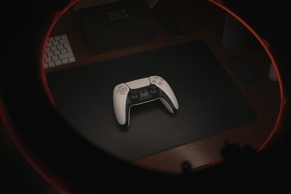 white game controller on black table