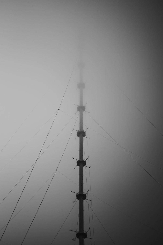 black metal pole under white clouds