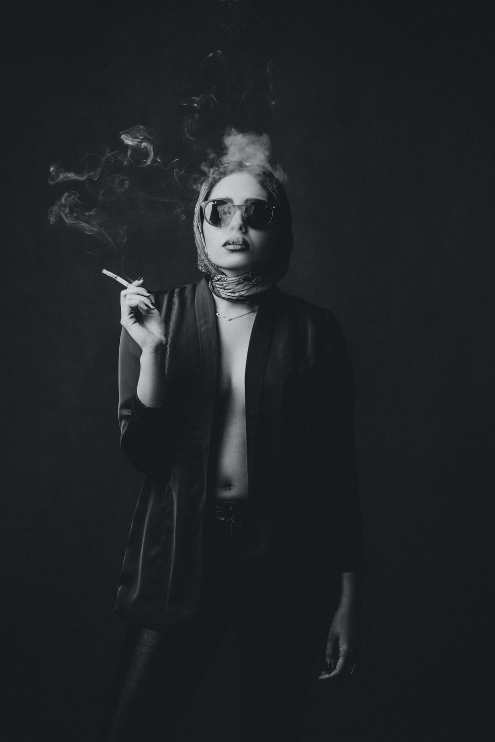 woman in black blazer and white face mask
