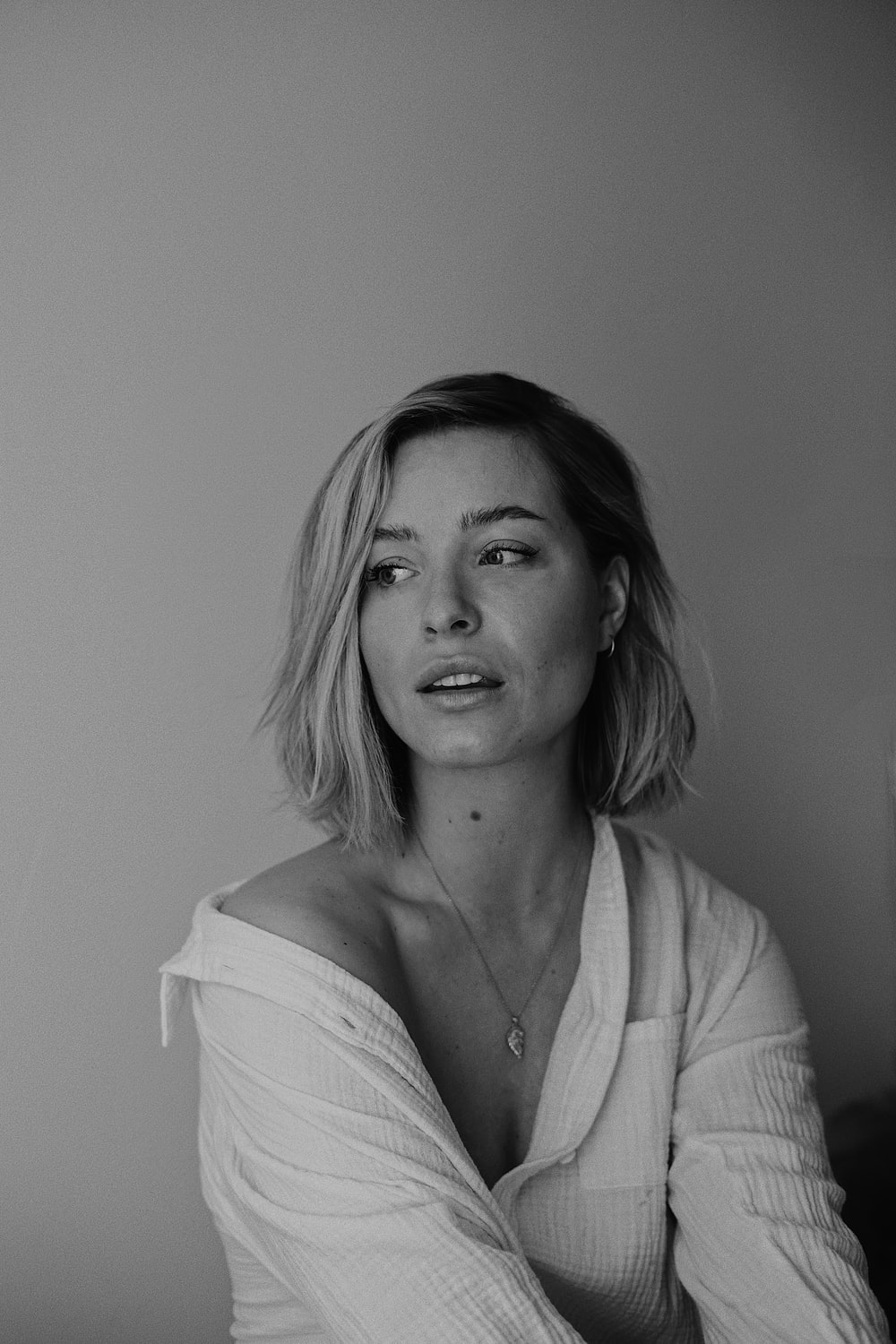 woman in white cardigan and white shirt