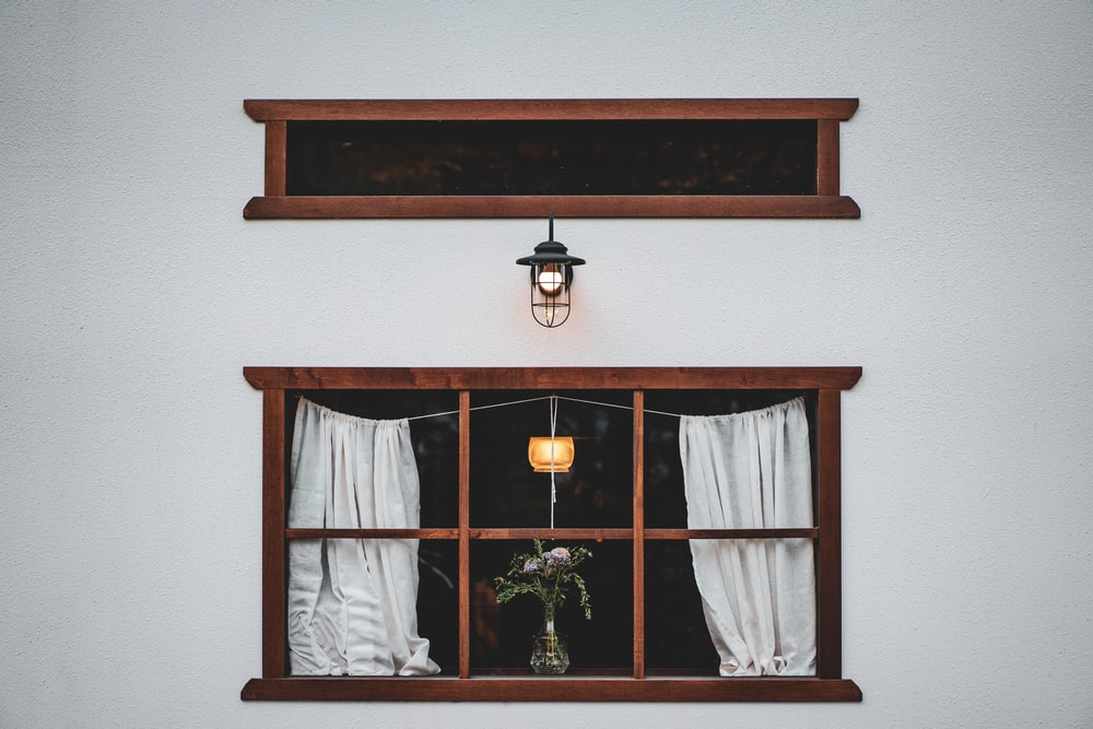 brown wooden framed glass window