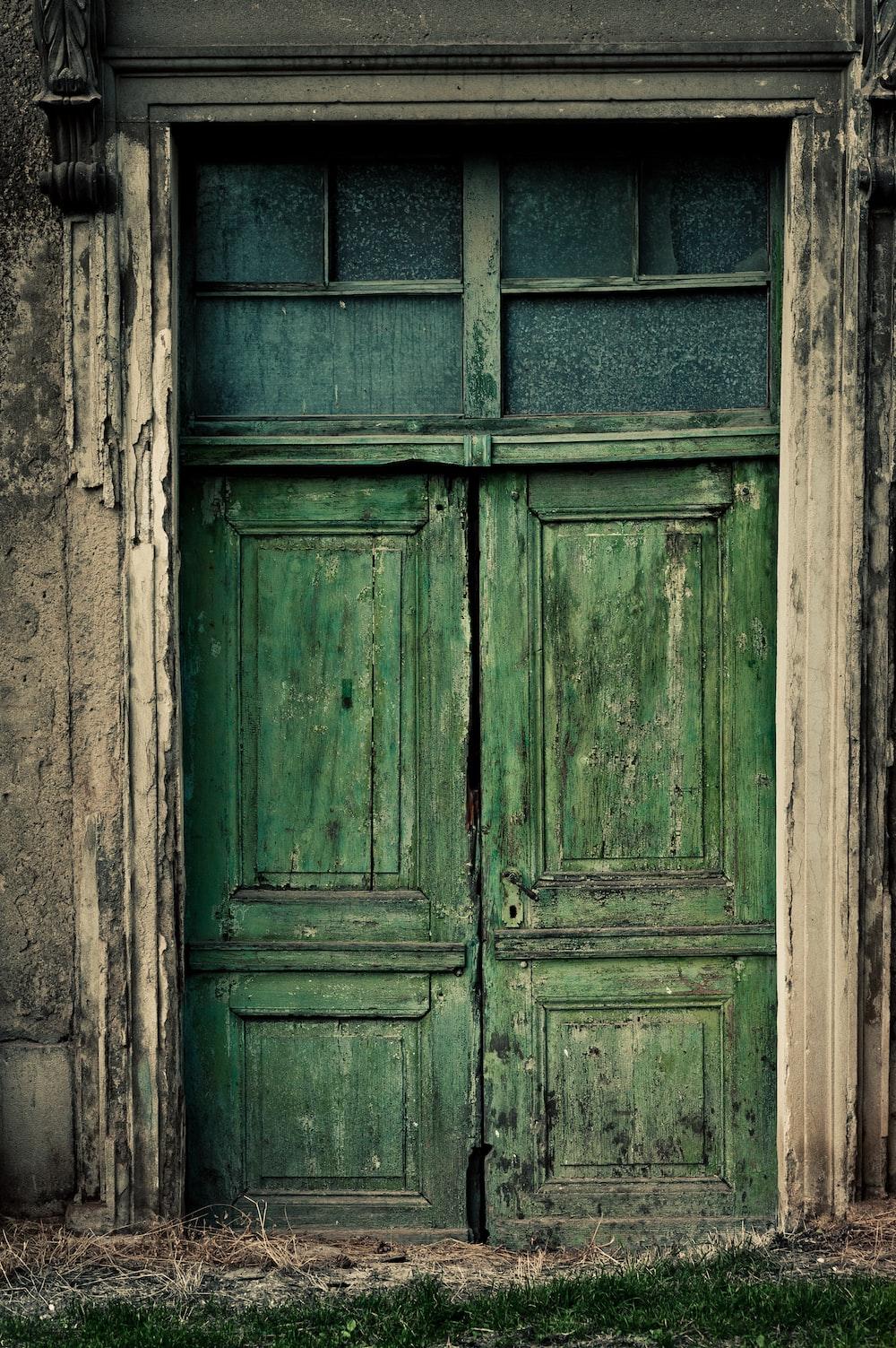 blue wooden door on gray concrete wall
