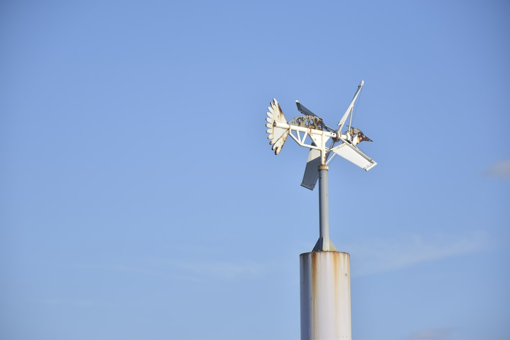 white and gray wind mill under blue sky during daytime