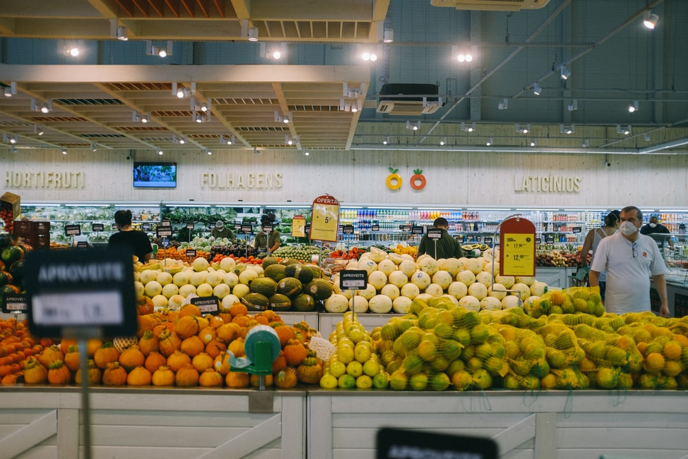 yellow and green fruits on white metal rack