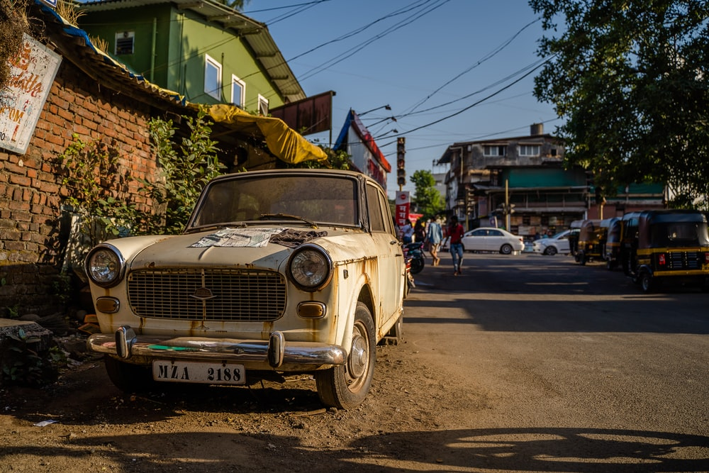beige classic car on road during daytime