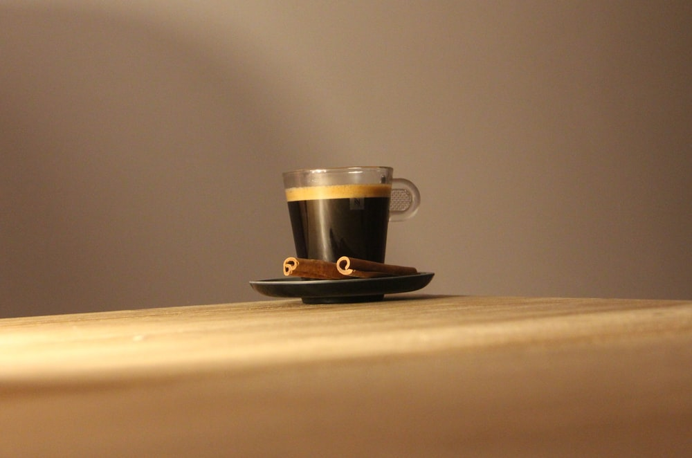 black and white ceramic mug on brown wooden table