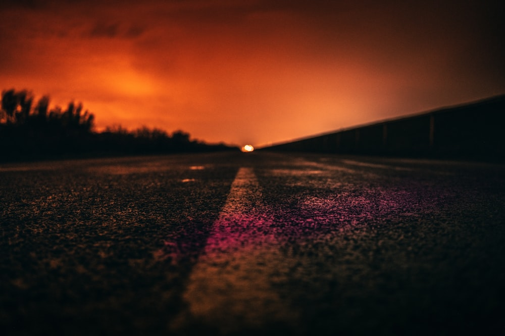 purple and black road during sunset
