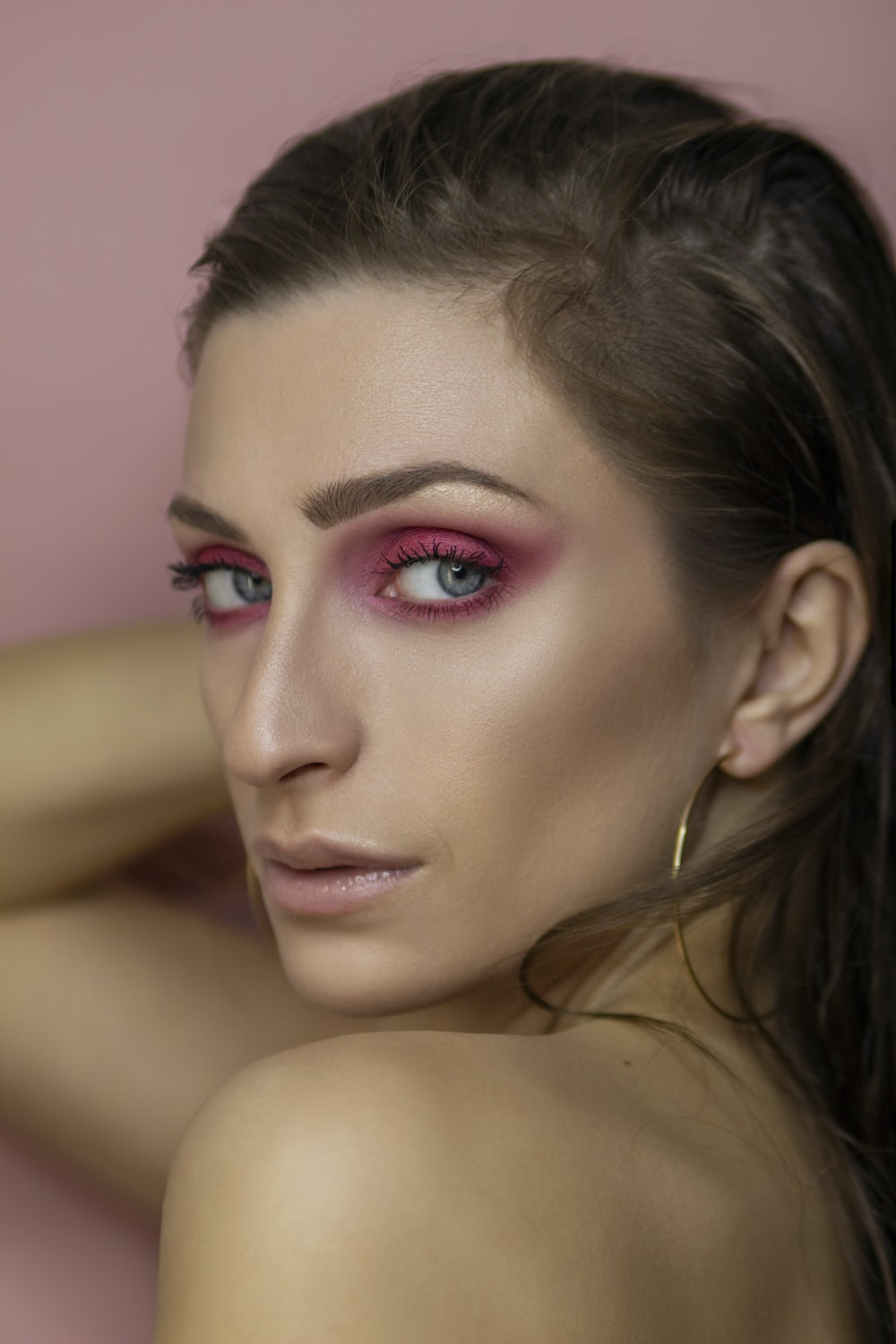 woman with pink lipstick and black mascara
