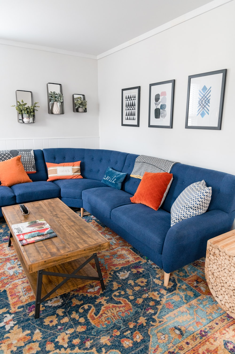 brown wooden coffee table beside blue couch