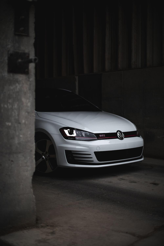 white bmw m 3 parked in garage