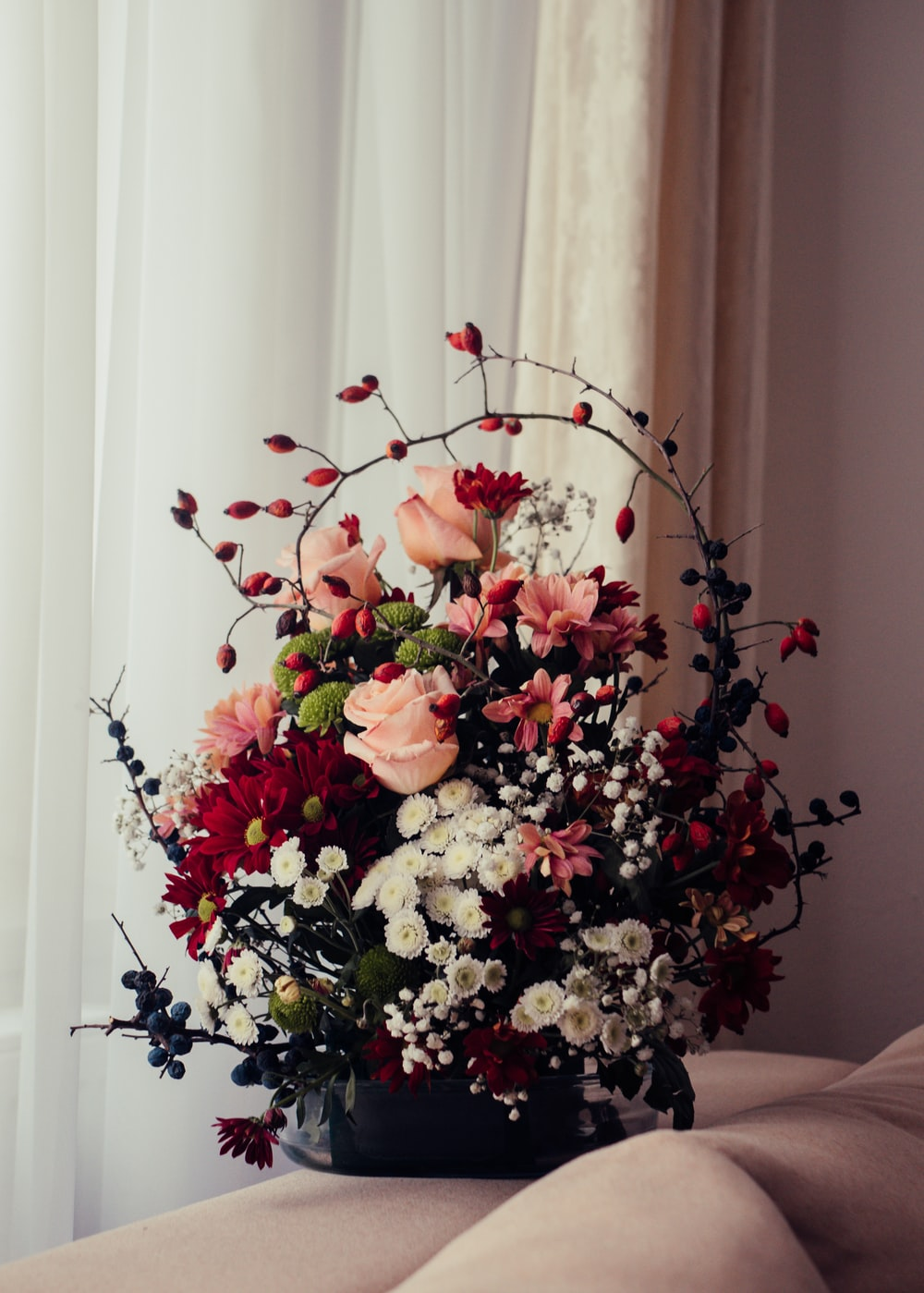 red and white flowers on vase