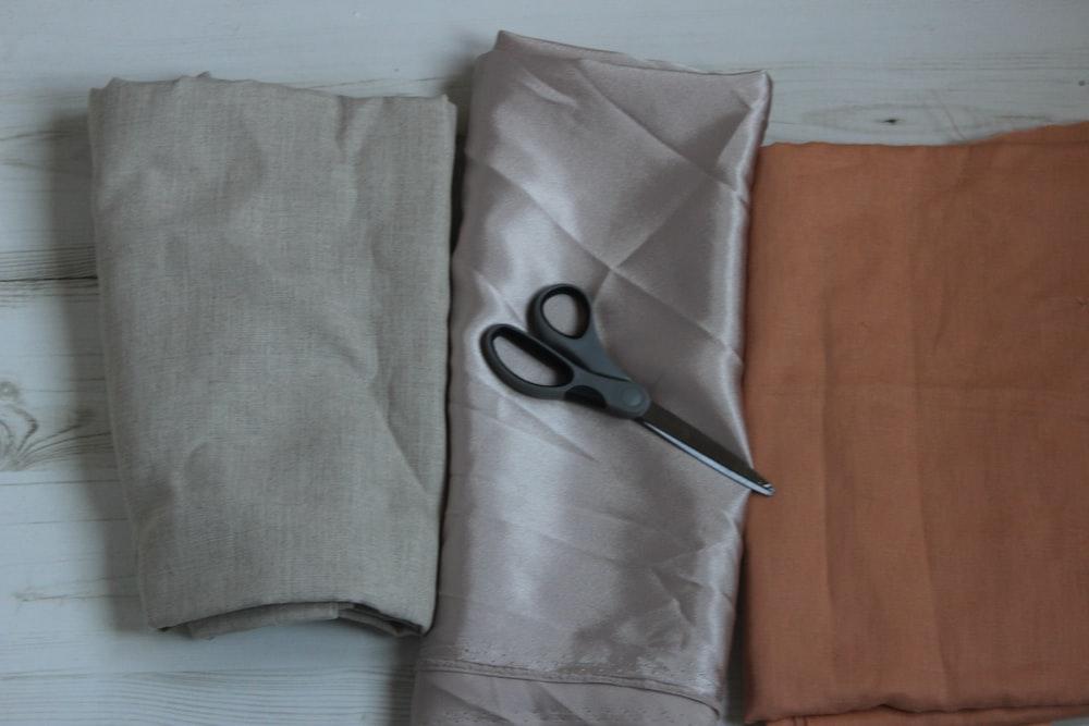 black scissors on gray textile