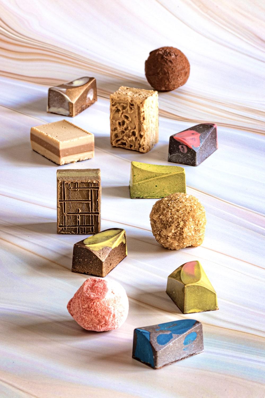 brown wooden blocks on white textile