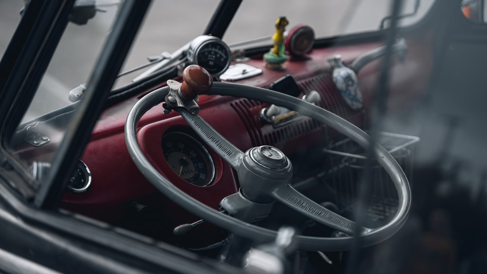 red and black car steering wheel
