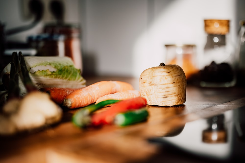 sliced vegetables on brown wooden chopping board
