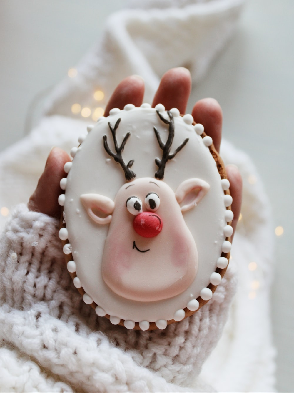 white and red ceramic snowman figurine