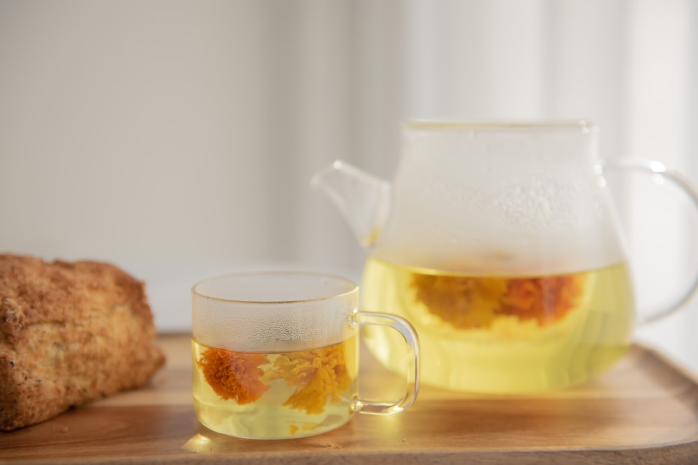 clear glass pitcher with yellow liquid