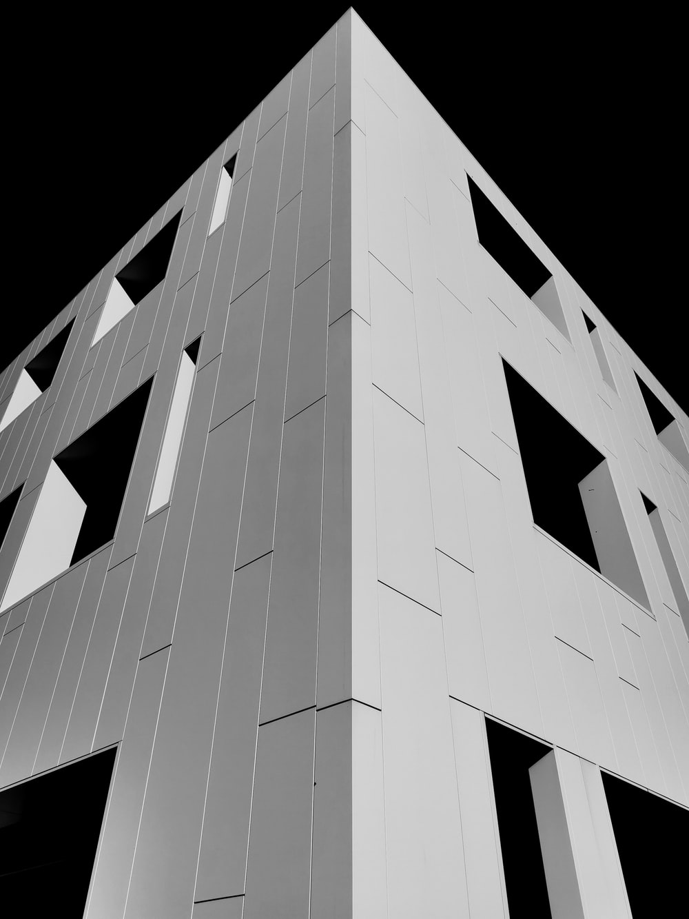 white concrete building with black background