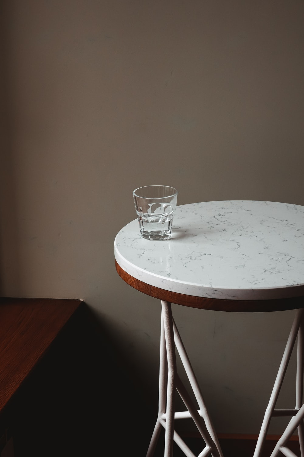 clear drinking glass on white round table